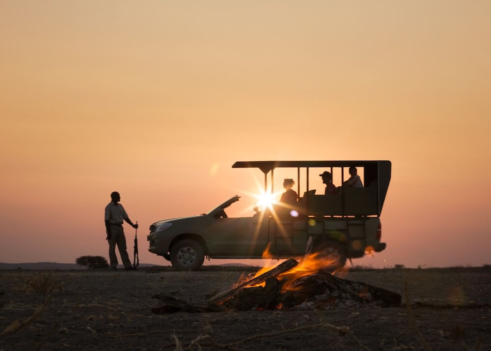 game-drive-sunset-natural-selection-camps-nature-cm-travels