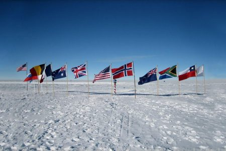 CM Travels: Antartica - Wildlife - White Desert Camp  - Emperor Penguin Colony - landscape -Flags
